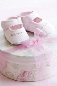 Pink corduroy baby shoes for a baby girl